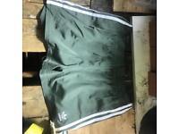 Green adidas shorts size 12