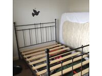 Double bed frame, metal construction with wooden slats for sale.