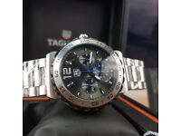 New boxed with papers silver strap grey dial blue features tag heuer formula 1 sweeping chronograph