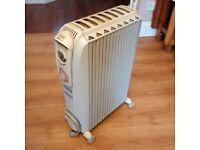 2kW oil filled de Longhi Dragon 3 radiator heater can deliver
