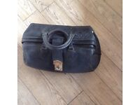 Leather Gladstone doctors bag complete with some vintage instruments