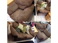 Beige two seater sofa with armchair