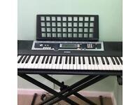 Yamaha keyboard on music stand