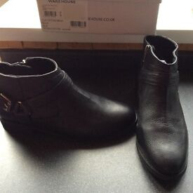 New black leather warehouse boots.