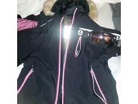 Brand new ski jacket and goggles. Both tog 24. Only worn once . In brand new condition .