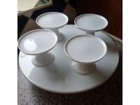 White porcelain cake stand and 4 cup cake stands