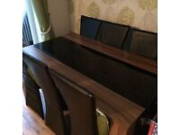 Dining table with 6 leather effect chairs