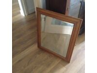 Small mirror with pine frame
