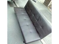 Sofa bed in excellent condition in brown faux leather£45 can deliver locally