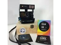 POLAROID SUN 660 AUTO FOCUS CAMERA W/ FILM