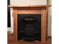 A Beautiful Cast Iron Fireplace With Wood Surround