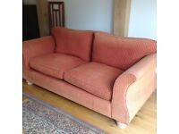 Two large settles, with feather seat and back cushions .