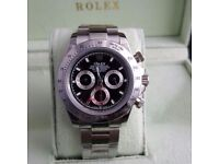 Silver Rolex Daytona , black face, silver bezel. Comes Rolex Boxed with paperwork