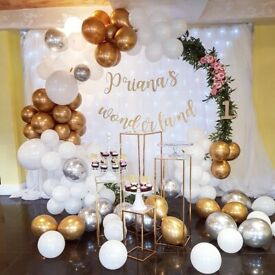 Backdrops, balloon arches, cake table set up, centerpieces, helium balloons, sweet cart, covers.