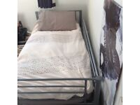 Grey metal beds suitable to become bunk beds