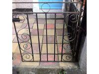 Black wrought iron garden gate.