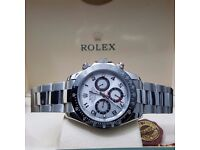 Silver Rolex Daytona with Silver Face and Black Bezel With Automatic Sweeping Hands