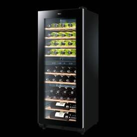 Haier new larder upright wine chiller fully working with guaranty good condition
