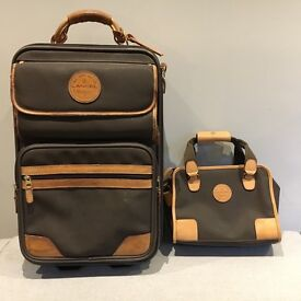 2-wheel Leather Suitcase from French luxury brand Lancel with matching toiletry bag