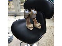 Nude size 5 stilettos. Brand new still in box. Ajvani, open toe with ankle strap.