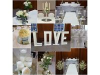 Venue dressing chair covers, table linen, light up letters, backdrop centerpiece, flowers etc