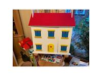 Dolls house plus lots of furniture and family members
