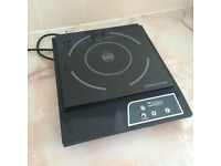 Portable mini induction hob - energy efficient cooking