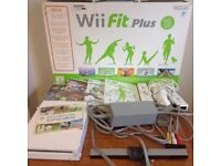 Nintendo Wii console + Wii Fit plus board and games.