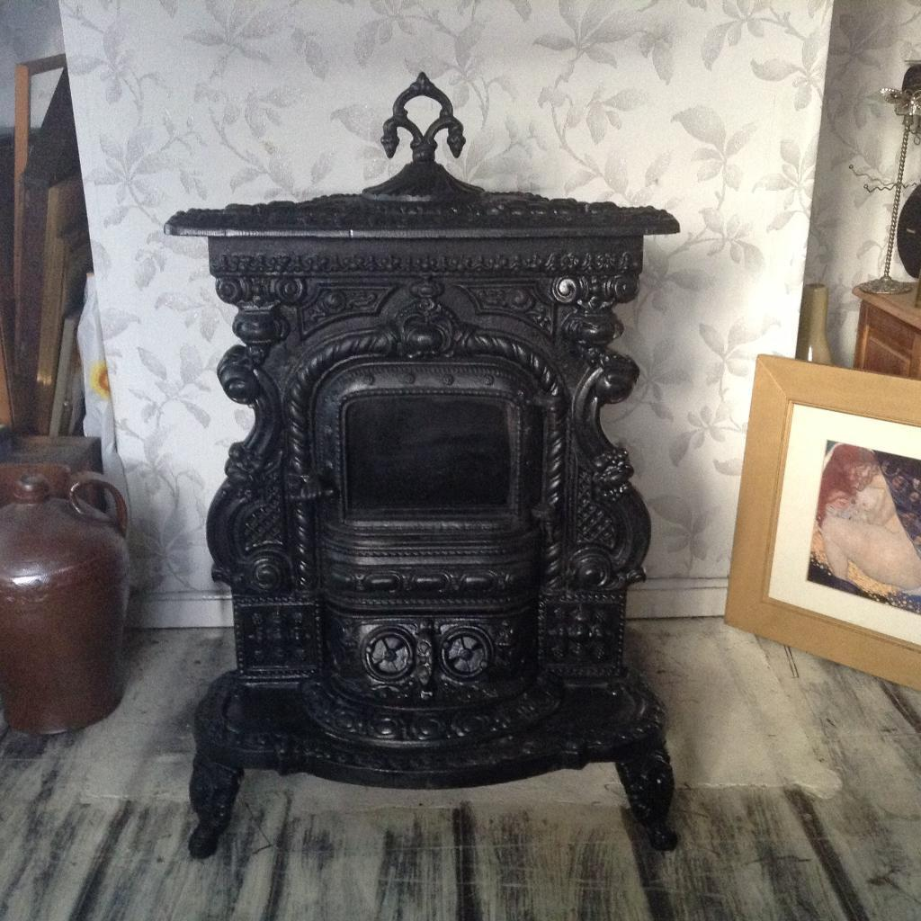 antique french wood burning stove cast iron very good condition