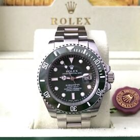 Rolex Submariner 'Hulk', Silver with green face and bezel. Complete with Box & paperwork.