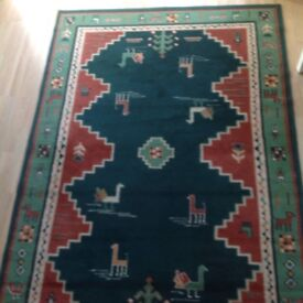 Large rug green and rust colours
