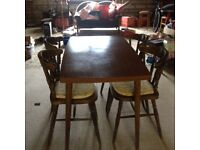 Dining table with four chairs.