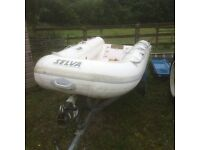 Selva tender,ridgid hull inflatable with 4hp Tohatsu 4 stroke motor and trailer.