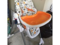 Chicco highchair orange white and grey with basket
