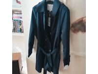 I am selling a new navy trench coat with tags on. Brand Jones & Harvey. Size 22/50.RRP 89£.