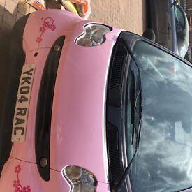 Pink convertable Smart Car excellent little car