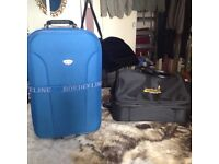 As New Lovely Expandable Suitcase with Wheels,,and Black Sports Bag With Three Compartments ,,