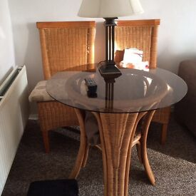 Beech wicker glass top table and 2 chairs with cushions in beige perfect condition