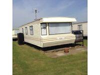 6 birth caravan next to beach in chapel st leanards excellent rates