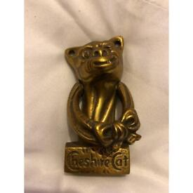 Vintage heavy brass small door knocker of the Cheshire Cat