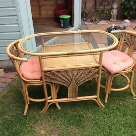 Two seater cane table and chairs