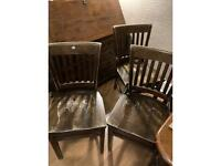Three wood dining chairs