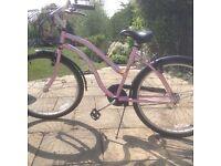 Pink beachcomber with metal front basket