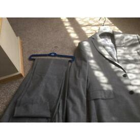 Men miss suit in grey