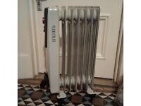 practically new de Longhi oil filled radiator heater