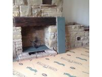Approximately 2 ton clean stone plus solid wood beam also slate hearth.