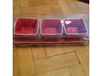 Red tray and dishes for dips