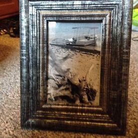 Black and white beach scene in a frame.