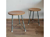 Set of 2 vintage factory stools with steel legs and hard ply top. Work chairs.