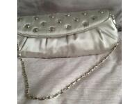 Small silver satin bag